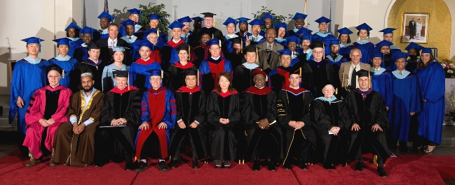 The Class of 2009 with representatives of the Board of Trustees, faculty, and special guests